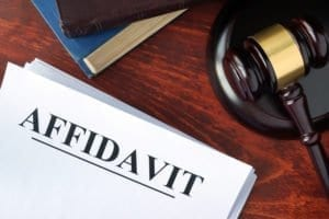 Affidavit, commission, notarize, commissioner of oaths, notary public, lawyer, counsel, identity verification, oath, affirmation, litigation, insurance, signing, proof of loss, surviving joint tenant, separation, death certificate, employment litigation, name change, financial disclosure, exhibits, gavel, documents, bible